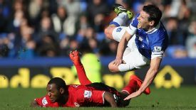 Kevin Theophile-Catherine tackles Gareth Barry during Everton's 2-1 victory.