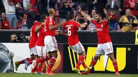 Benfica celebrate after Ezequiel Garay gave them the lead against Spurs.