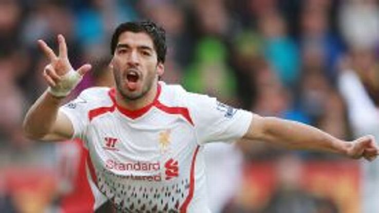 Luis Suarez scored three times as Liverpool triumphed at Cardiff.
