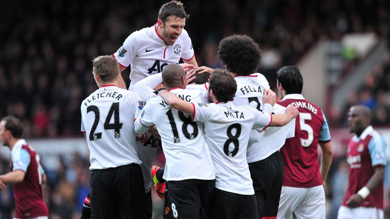 Man Utd players mob Wayne Rooney following his spectacular opener against West Ham.