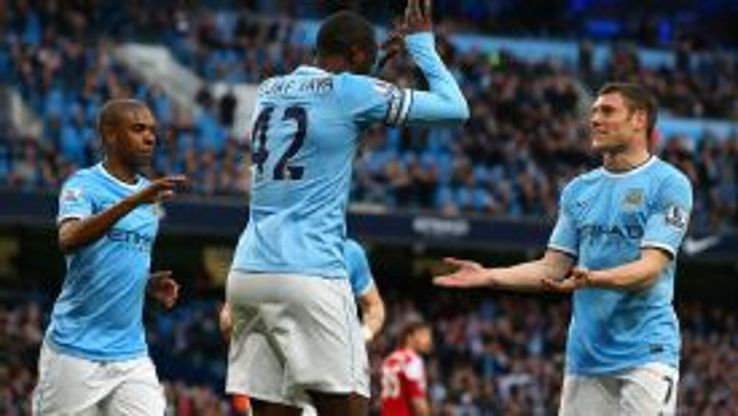 Yaya Toure celebrates the first of two goals against Fulham.