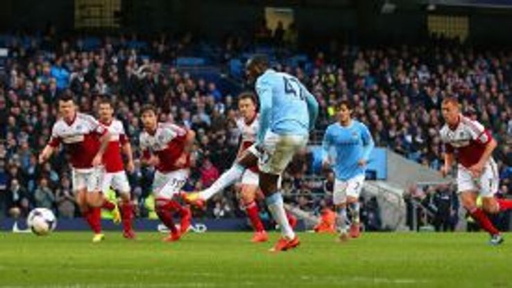 Yaya Toure kept his cool to give Manchester City the lead against Fulham.