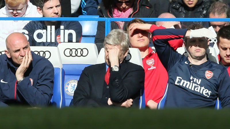 Arsene Wenger watches on as his Arsenal side slump to a miserable defeat at Chelsea.