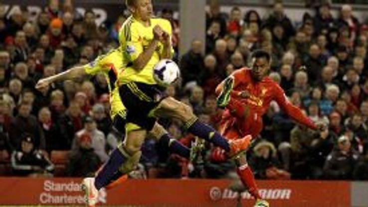 Daniel Sturridge curls home Liverpool's second goal.