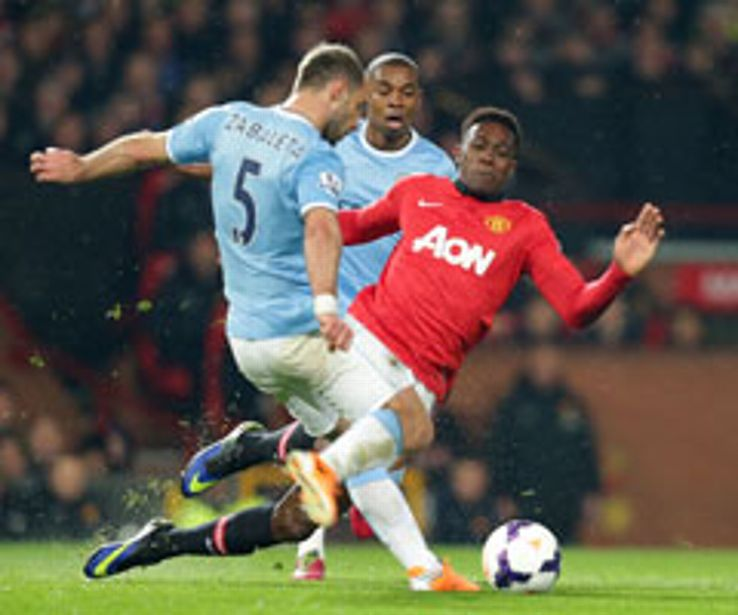 Danny Welbeck challenges Pablo Zabaleta during the Manchester derby.