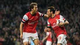 Arsenal celebrate getting back into the game through Mathieu Flamini.
