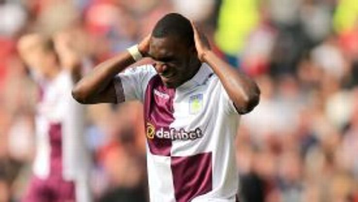 Christian Benteke shows his frustration after missing a golden chance to equalise against United.