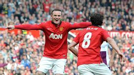 Juan Mata celebrates with Wayne Rooney.