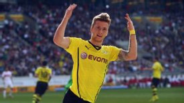 Dortmund's Marco Reus celebrates a starring performance.