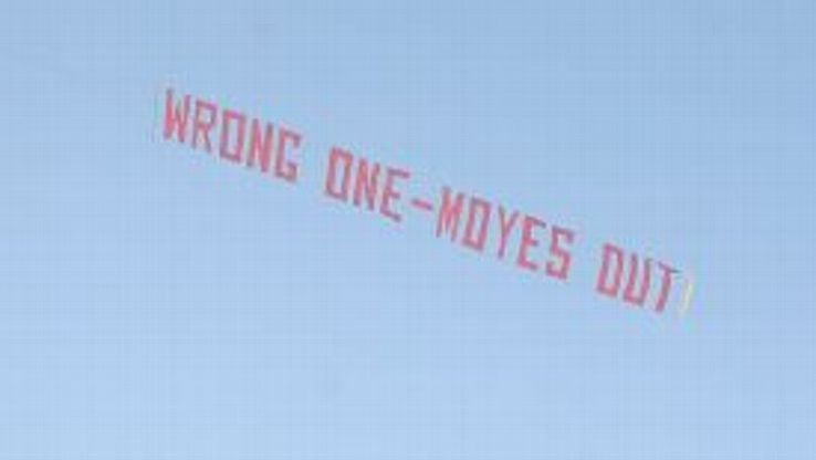 A banner protesting against David Moyes is flown over Old Trafford.