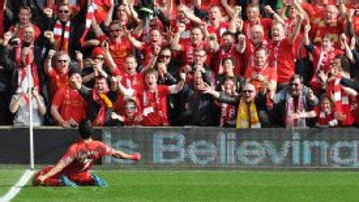 Luis Suarez celebrates in front of the Liverpool fans.