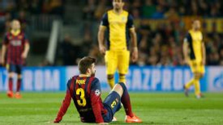 Gerard Pique came off injured after landing awkwardly on his back.