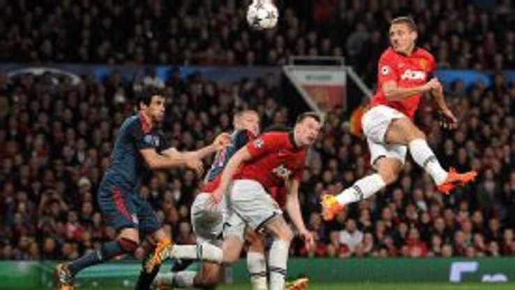 Nemanja Vidic heads Man Utd into thelead against Bayern Munich.