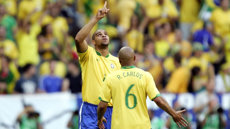 Brazil's Adriano, left, celebrates with teammate Roberto Carlos after scoring his side's opening goal during the Brazil v Australia Group F match at the World Cup stadium in Munich, Germany, Sunday, June 18, 2006.