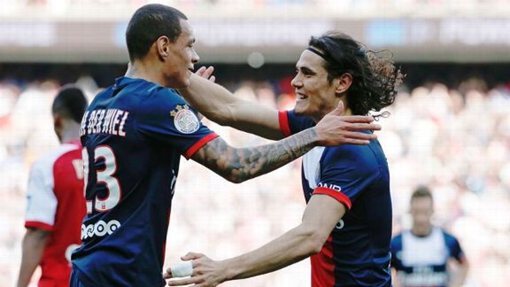 Edinson Cavani celebrates with Gregory van der Wiel after opening the scoring against Reims.