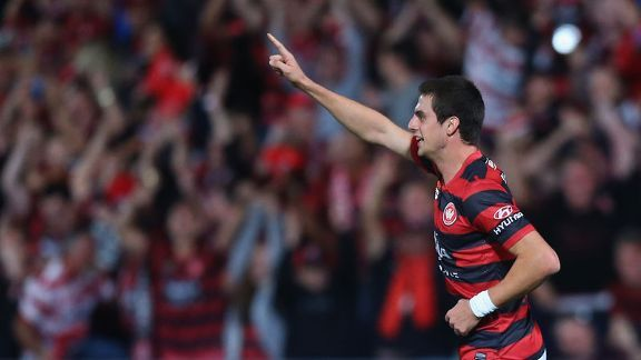 Tomi Juric celebrates his equaliser for the Wanderers.