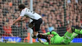 West Ham goalkeeper Adrian concedes a penalty for bringing down Liverpool's Jon Flanagan.
