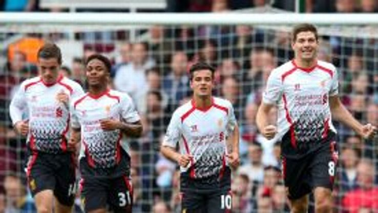 Steven Gerrard celebrates after tucking home his penalty at West Ham.