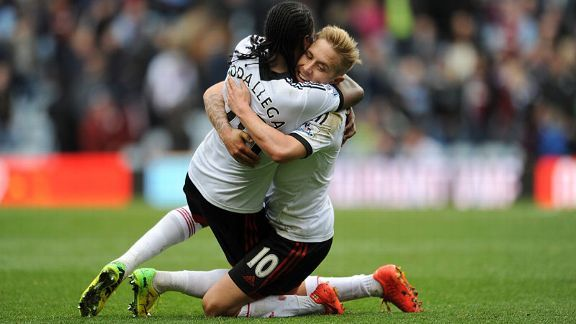 Hugo Rodallega and Lewis Holtby celebrate during Fulham's 2-1 win at Aston Villa.