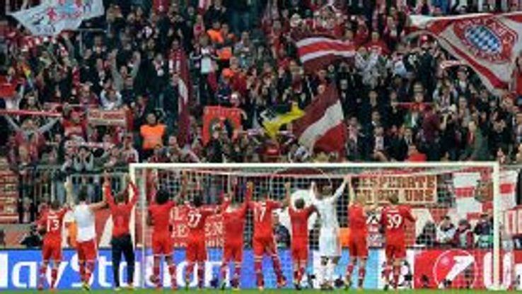 Bayern Munich players salute their fans after overcoming Man United.