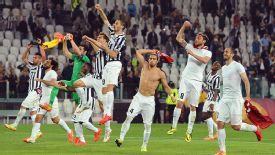 Juventus celebrate reaching the Europa League semifinals after beating Lyon.
