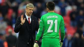 Arsene Wenger congratulates his match-winning goalkeeper Lukasz Fabianski.