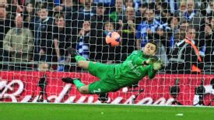 Lukasz Fabianski saves Jack Collison's penalty