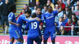Chelsea celebrate their goal against Swansea.