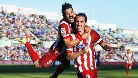 David Villa celebrates with goalscorer Diego Godin after he gave Atletico the lead.