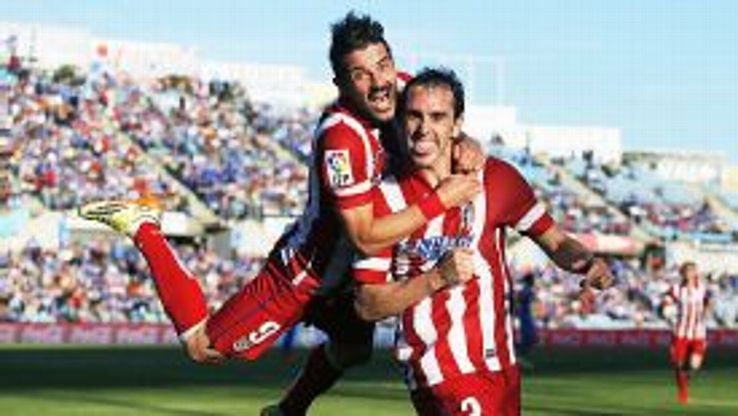 David Villa celebrates with goalscorer Diego Godin after he gave Atletico the lead.
