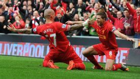 Martin Skrtel celebrates with Steven Gerrard after scoring.