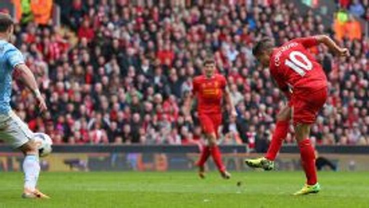 Philippe Coutinho of Liverpool scores his team's third goal