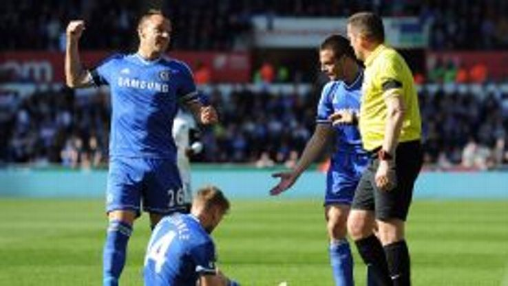 Chelsea captain John Terry remonstrates with Phil Dowd as Swansea defender Chico Flores fouls Andre Schurrle to earn a second yellow card