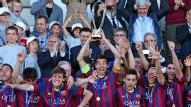 Barcelona players celebrate winning the UEFA Youth League after beating Benfica in the final.