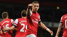 Lukas Podolski celebrates after scoring his second against West Ham.