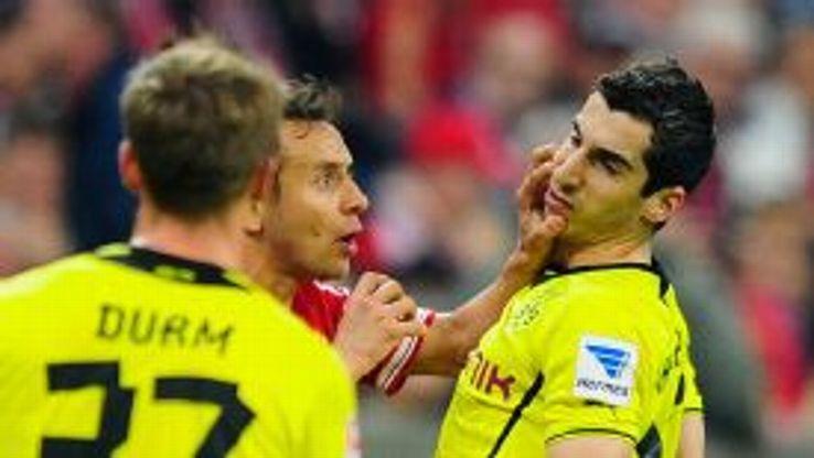 Rafinha was dismissed for raising his hand to Henrikh Mkhitraryan during Bayern's defeat.