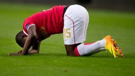 PSV's Jetro Willems lies injured on the pitch before coming off.