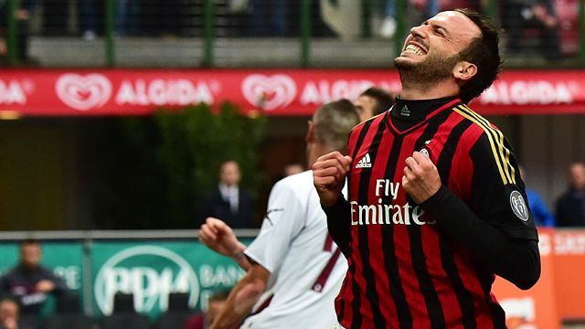Giampaolo Pazzini celebrates after netting Milan's third against Livorno.