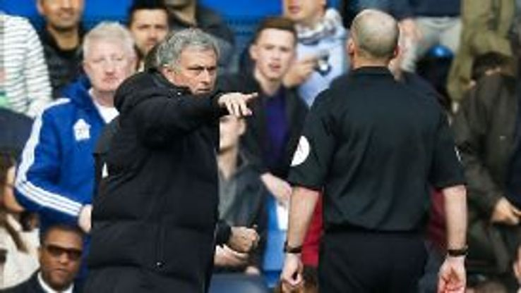 Jose Mourinho exchanges words with referee Mike Dean during Chelsea's defeat to Sunderland.