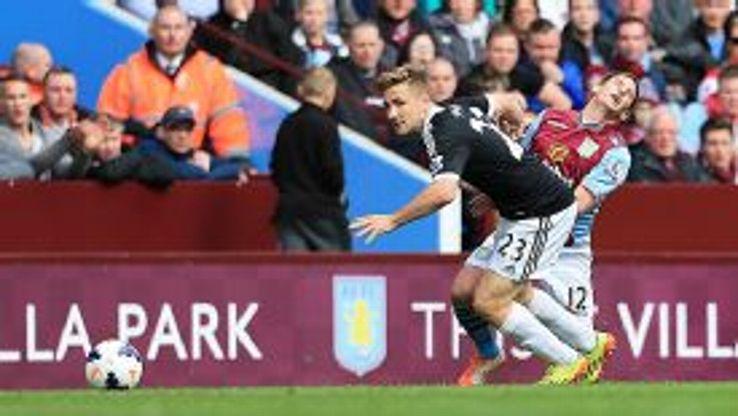 Southampton defender Luke Shaw keeps Villa's Marc Albrighton at arm's length.