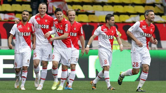 Dimitar Berbatov celebrates with his Monaco teammates after scoring the only goal of the game.
