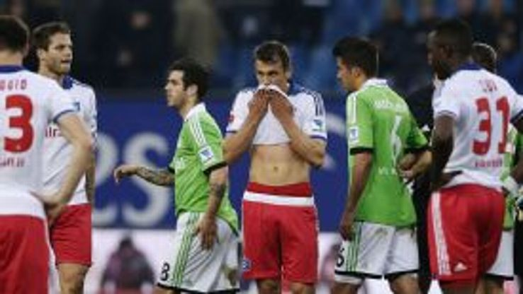Ivo Ilicevic and his Hamburg teammates show their frustration after their latest defeat.