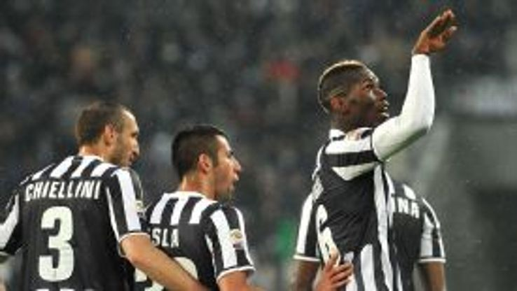 Paul Pogba celebrates his decisive opener against Bologna as Juventus edged closer to the title on Saturday