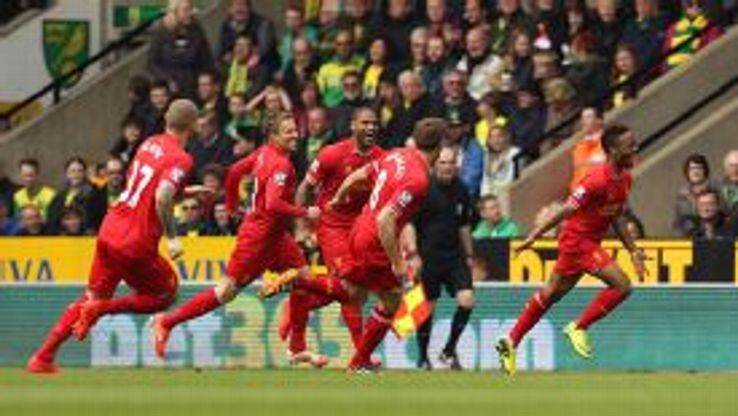 Raheem Sterling celebrates giving Liverpool the early lead at Norwich.