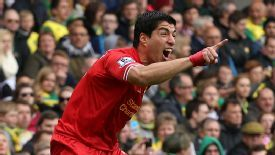 Luis Suarez celebrates Liverpool's second goal as they took a giant stride towards the title at Norwich.