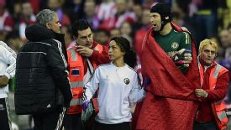 Jose Mourinho checks on Petr Cech after he was forced off injured at Atletico Madrid.