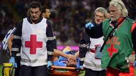 Gonzalo Higuain is stretchered off at the San Siro.