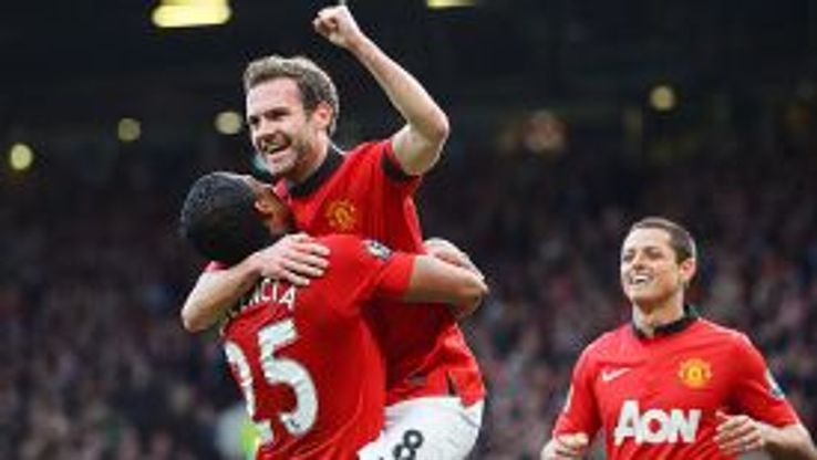 Man United celebrate Juan Mata's second against Norwich.