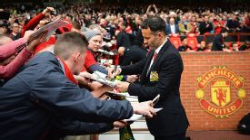 Ryan Giggs signs fans' programmes ahead of his first game as Man United's interim manager.
