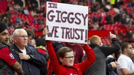 A young United fan welcomes Ryan Giggs to the manager's chair.